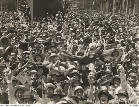 Sydney, NSW. 1918-11-11. Crowd in Martin Place celebrating the news of the signing of the armistice. Remembrance Day. First World War One Australian War Memorial Canberra