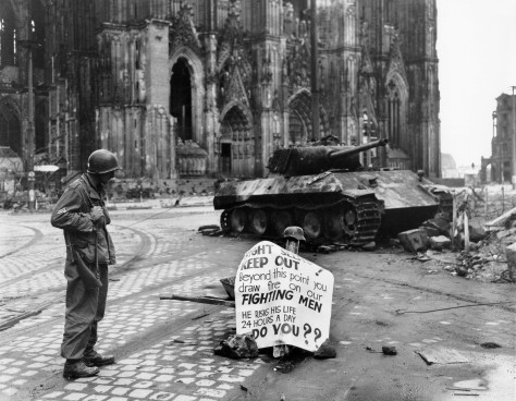 Warning_sign_in_cologneA Cpl. of 82nd Airborne Division reads a warning sign in the street Cologne, Germany, 4 April 1945. Second World War Two
