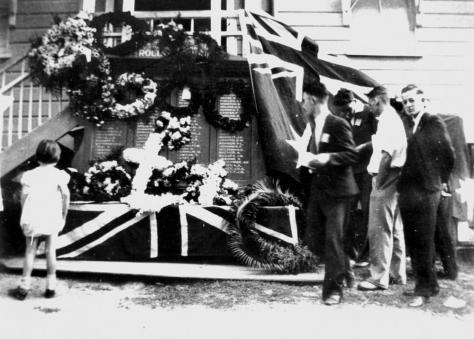 Honour Board at the School of Arts Hall, Canungra, 1937. Wreaths laid aon Anzac Day 25th April 1937. Inscription on back of photograph reads Dad, Dave Day built this hall. Hall burnt dow