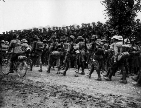 Australian_6th_Brigade_marching_Somme_(AWM_EZ0092)10th August 1916 First World War One Near Warloy Somme Australian Infantry marching to their rest billets after fighting at Battle of Po