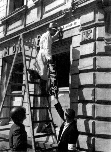 Denazification-street Workers removing the signage from a former Adolf Hitler Street in Trier, Germany. 12th May 1945. Second world War Two