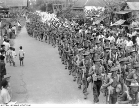 Australian_2-31_Bn_parading_through_Bandjermasin_17th September_1945 Enthusiastic welcome after Japanese occupation. Second World War Two..