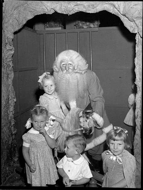 Children pose with Santa Claus in New South Wales, Australia on the 10th of November, 1941. Australia had been at war for more than two years.Sam_Hood