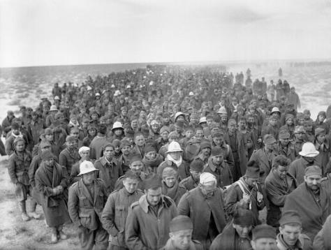 Italian_soldiers_taken_prisoner_during_Operation_CompassA column of Italian prisoners captured on Bardia, Libya, march to a British army base on 6 January 1941. Australian Second World