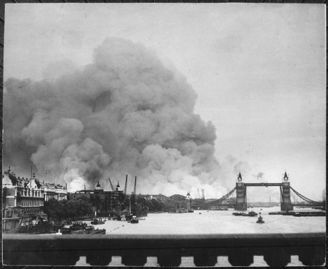 Second World War Two Picture taken during first mass air raid on London 7th September 1940 describes more than words ever could, the scene in London's dock area. Tower Bridge against a b