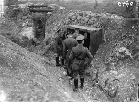 The_Battle_of_the_Somme,_July-november_1916_Q970King George V inspecting a German dug-out near Fricourt, 10th August 1916.