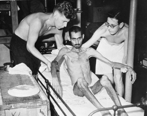 The_Far_East-_Singapore,_Malaya_and_Hong_Kong_1939-1945_A30522Indian soldier who'd been kept as a Japanese prisoner of war in Hong Kong, being cared for by British nurses aboard the hosp