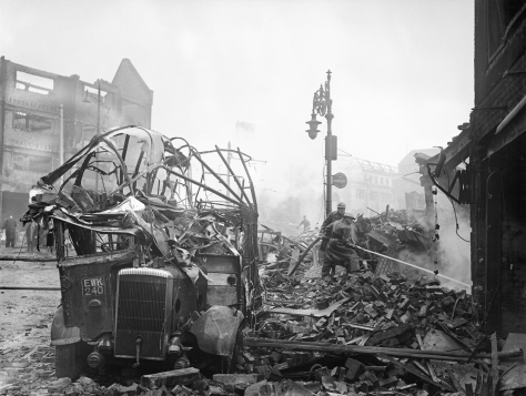 A wrecked bus stands among a scene of devastation in the centre of Coventry after the major Luftwaffe air raid on the night of 14-15 November 1940. Second World War Two England United Ki