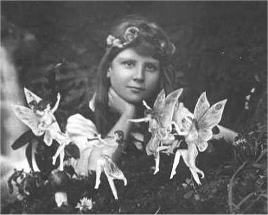 Cottingley_Fairies_1The first of the five photographs, taken by Elsie Wright in 1917, shows Frances Griffiths with the alleged fairies.