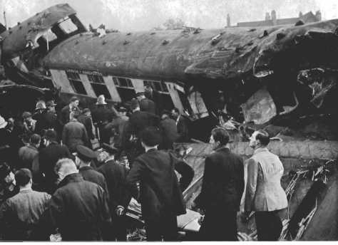 The scene looking south over the aftermath of the Harrow and Wealdstone train crash on 8 October 1952.Rescue workers around wrecked coaches after the Harrow and Wealdstone train crash on