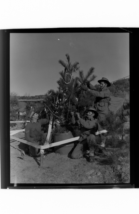 Christmas_in_Korea,_1953_(3116644983) 23rd December 1953 Korean War The finishing touches are made to the Christmas tree at C Company, 3rd Battalion, The Royal Australian Regiment electr