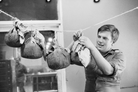 Christmas_in_Vietnam,_1971_(3116643779)South Vietnam. Private (Pte) David McColl of Page in Canberra ACT, hanging puddings to mature before Christmas