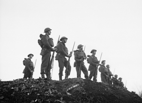 Soldiers of the East Surrey Regiment pose with fixed bayonets at Chatham in Kent, 25 November 1940. England Second World War Two Britain