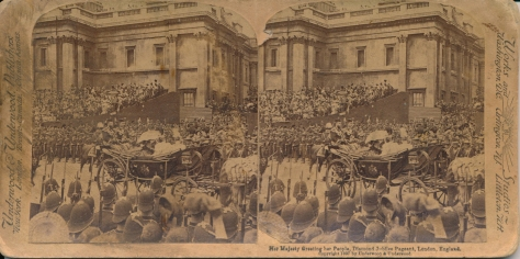 Her_Majesty_Greeting_her_People,_Diamond_Jubilee_Pageant,_London,_England Queen Victoria riding a coach through a crowd of onlookers during her Diamond Jubilee procession. 22nd June 1897