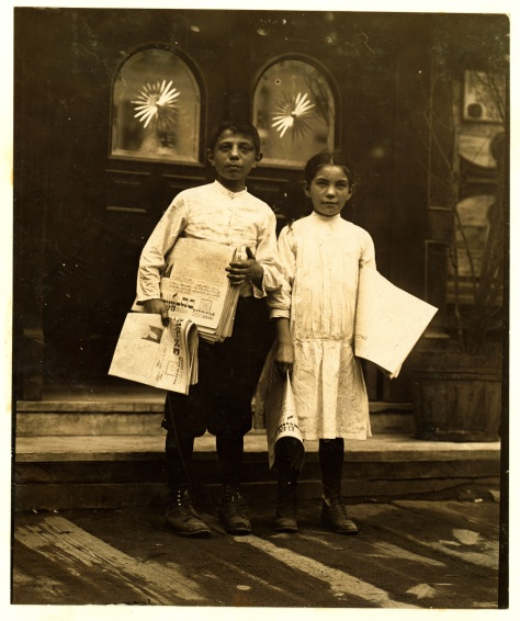 Lewis_Hine,_Newsgirl_and_boy_selling_around_saloon_entrances,_Bowery,_New_York,_1910 Newsgirl & Boy Selling around saloon entrances. Bowery. Location New York, New York. Photograph by Lewis Wickes Hine, July 1910. Newsboy N