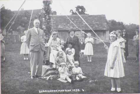 Luddington_May_Day_1933 Luddington May Day 1933, on the Village Green. The former blacksmith's shop is in the nearer background. Warwickshire England 1st May 1933