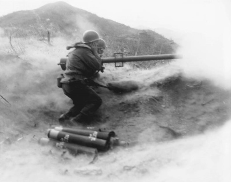 1951 SC385162 - KOREAN CONFLICT Powder smoke and dust billow as a recoilless rifle team of Co. D, 7th infantry Regiment, 3rd U